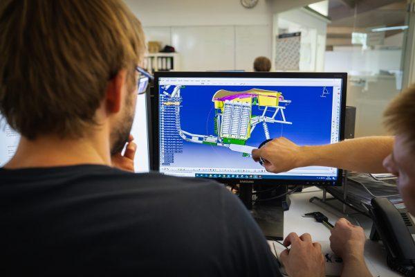 man in black shirt playing computer